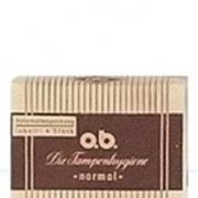 Bilde av en tidligere versjon av o.b.® tampong emballasje. Gul og brun med striper.